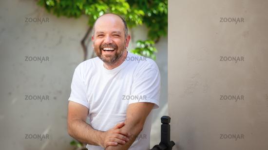 bearded bald man laughing