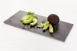 Fresh ripe avocado slices appetizer.