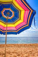 Colorful umbrella close-up on a tropical beach