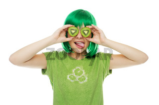 Cute young girl in a green wig