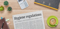 A newspaper on a desk with the headline Hygiene Regulations