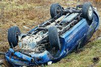 car crash, blue car overturned on the road transport traffic accident