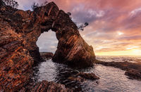 Morning sunrise at dramatic sea arch cave