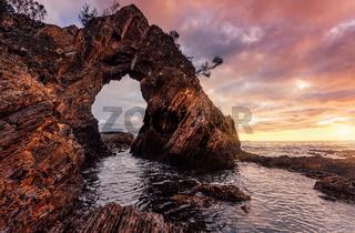 Morning sunrise at dramatic sea arch cave