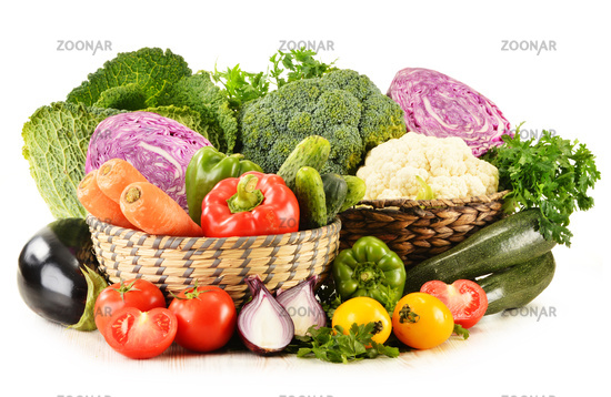 Composition with variety of fresh organic vegetables isolated on white