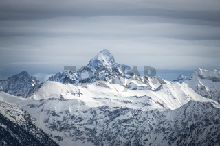Amazing dramatic Winter View to the snow covered Mountain Hochvogel in Allgau Alps, Bavaria, Germany.