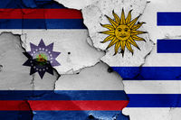 flags of Paysandu Department and Uruguay painted on cracked wall