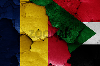 flags of Chad and Sudan painted on cracked wall