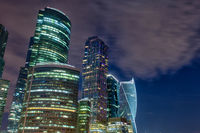 Moscow city skyscrapers and reflection in the Moscow river against the blue sky on a summer night