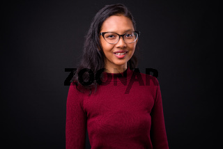 Portrait of happy young beautiful Asian businesswoman