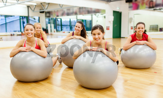 smiling people working out in pilates class