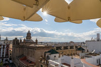 detail view of the Metropol Parasol in Seville with a sun star and skyline of Sevlile behind