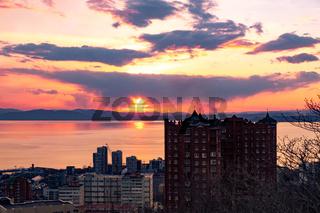 Vladivostok, Russia - Apr 07, 2019: Panoramic view of the city of Vladivostok against the sunset.