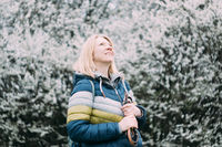 Authentic smiling blonde woman. Retro analog vintage swirley bokeh film look. Real middle aged peopl