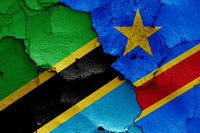 flags of Tanzania and DR Congo painted on cracked wall