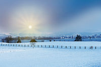 Winter landscape early morning after a light snowfall in Zug,