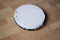 robotic or robot vacuum cleaner on laminate floor