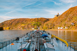 Binnenvaart, Translation Inlandshipping on the river rhein in Germany during sunset hours, Gas tanker vessel rhine river oil and gas transport