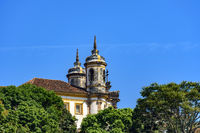 Side view of historic church in baroque and colonial style from the 18th century amid the hills and