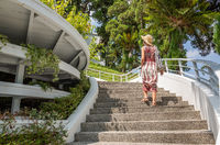 woman walking at a stairs