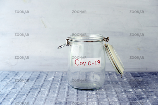Empty money jar with covid19 label