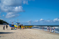 Holidaymakers and fishing boats on the beach of Rewal on the Polish Baltic Sea coast