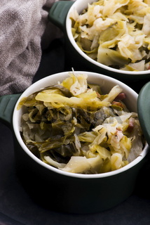 Stew of white cabbage and bacon. Vegetables, background