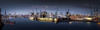 The port of Hamburg in the evening with Elbphilharmonie and Landungsbrücken