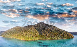 Mountains and coral reef on a wonderful seascape scenario, aerial view