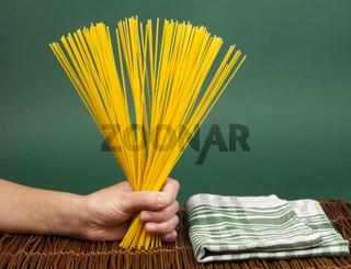 Female hand holding spaghetti