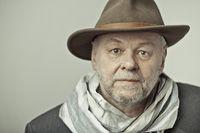 Older man with beard and hat head looks joyful