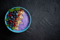 Healthy food concept. Fresh fruit Blackberries and currants yogurt or smoothie with oat and flakes