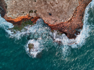 Rocky coastline and sea aerial photography. Spain