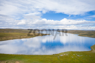 blue sky reflected in the beautiful lake