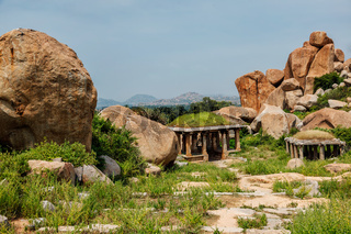 Ancient ruins in Hampi on sunset. India