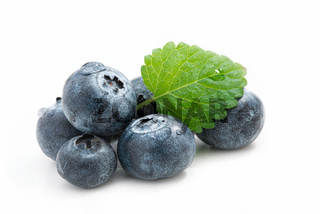 Fresh blueberries with leaf isolated against white