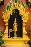 Standing Buddha Statue at Wat Phra That Doi Phra Chan in Mae Tha District