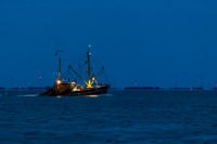 Shrimp boat at night