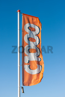 Flag of Dutch drugstore C1000 blowing in the wind