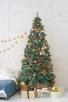 Decorated Christmas tree with gifts in Festive bedroom interior