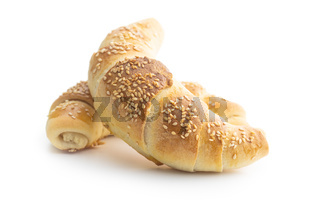 Salted croissant bun roll with sesame seeds. Homemade pastry