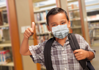 Hispanic Student Boy Wearing Face Mask with Thumbs Up and Backpack in the Library