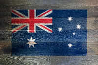 Australia flag on rustic old wood surface background