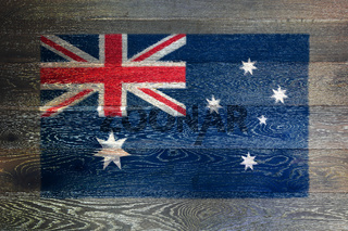 Australia flag on rustic old wood surface background