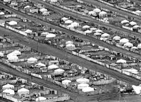 Informal settlement by yurts and wooden huts on the edge of Ulaanbaatar, Mongolia, 1977