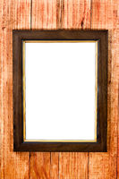 Wooden picture frame on a wooden background