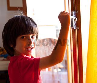 boy opens the door of a new home