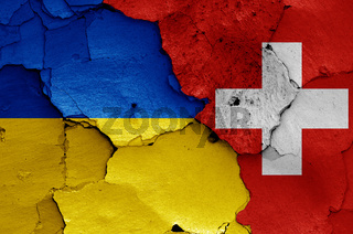 flags of Ukraine and Switzerland painted on cracked wall