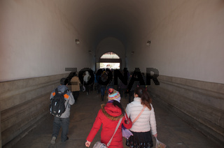 Chinese People And Tourists Walking Through The Tiananmen Gate Into The Forbidden City In Beijing, China