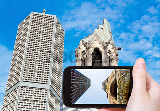 tourist taking photo of gedachtniskirche in Berlin